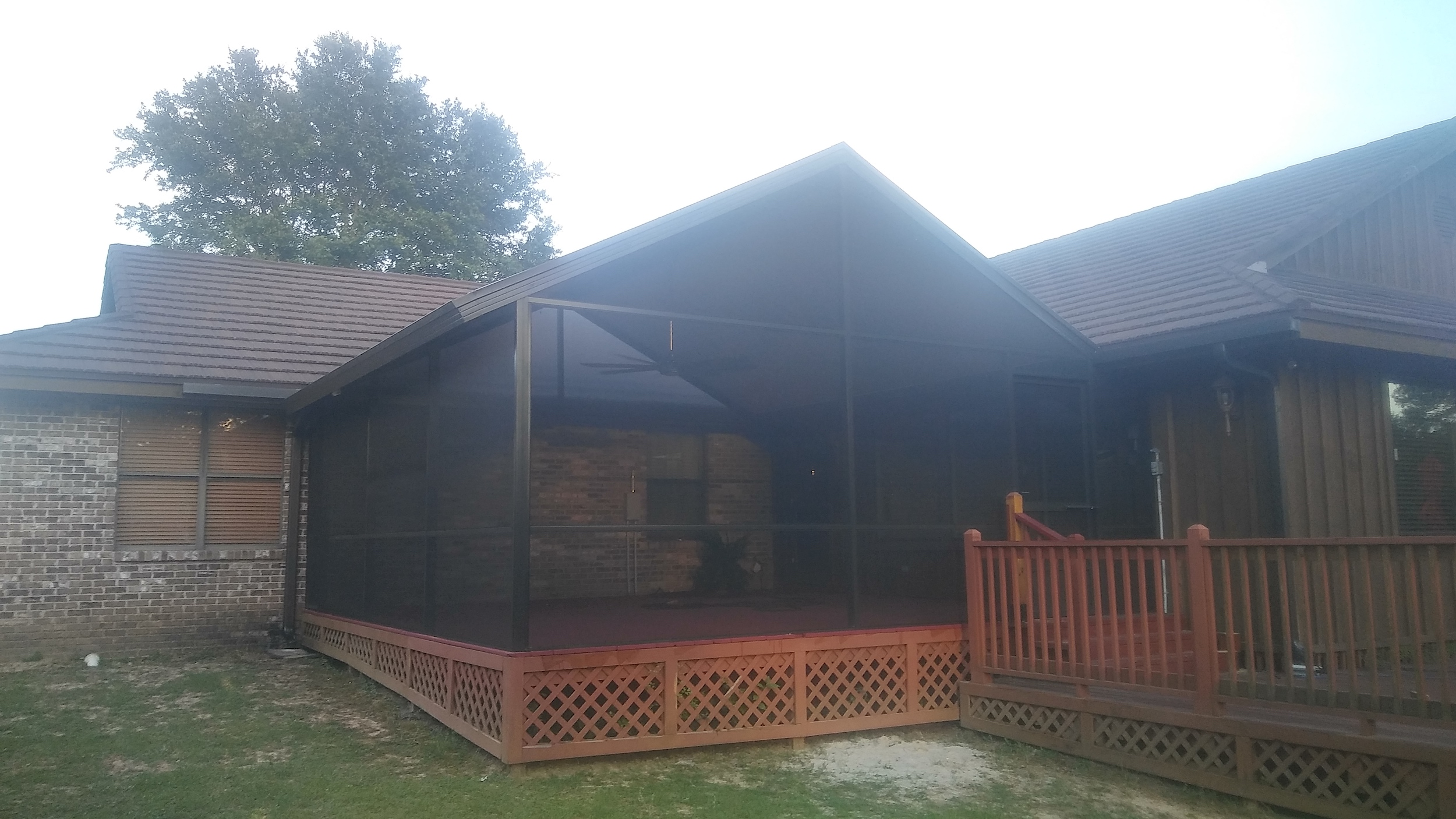 Adding an aluminum screen enclosure to a porch or deck creates a new outdoor living space, affordably.